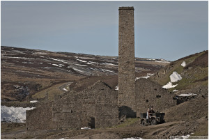 People out feeding the grouse on a quad bike, passing by Old Gang smelt mill.