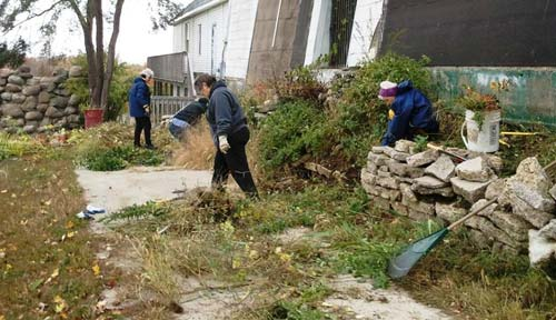 Volunteers clean up around the base of the Irish Hills towers, 2014