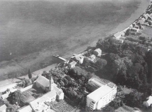 In this pre-WWII aerial photo of Lopud, the Grand Hotel's rooftop tennis court (with bleachers) is visible