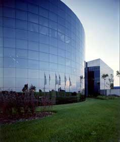 The round building of Bugatti Automobili's corporate complex hosted new car deliveries and Gala events, the designers and engineering departments, and the company's computer systems.