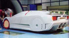A model of an early Bugatti EB110 prototype is prepared for wind tunnel testing.
