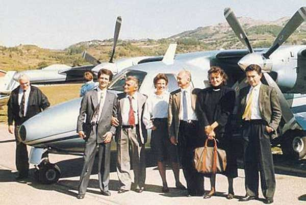 Early Bugatti Automobili SpA team flight, L to R: Romano Artioli (behind the plane), Jean-Marc Borel, Ferruccio Lamborghini, in the gray tie is Paolo Stanzani, and on the far right is designer Marcello Gandini.