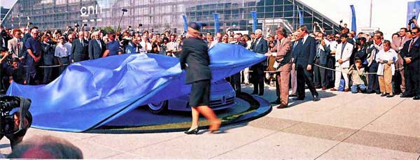 Alain Delon and Renata Kettmeir Artioli reveal the EB110 at the Bugatti Expo in Paris on Ettore Bugatti's 110th birthday, September 15th, 1991.