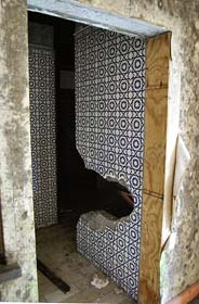Bathroom tile at the Monte Palace destroyed by vandals, circa 2013