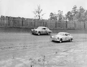 Sara Christian and Curtis Turner duel it out during a 1949 race at North Wilkesboro Speedway.