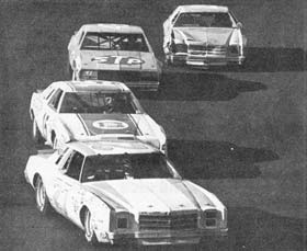 NASCAR HALL OF FAME PHOTO: Benny Parsons leads Bobby Allison, Richard Petty, and Dale Earnhardt in the 1979 Holly Farms 400 at North Wilkesboro Speedway