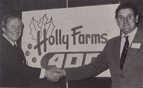 Enoch Staley and Frank Rhodes announce the new Holly Farms sponsorship deal at North Wilkesboro Speedway, circa 1979.