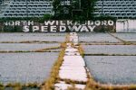 Today grass grows through the North Wilkesboro Speedway