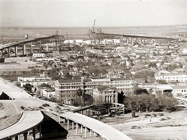 Construction of Harbor Bay Bridge in Corpus Christi, circa 1959. 1914 Nueces Courthouse appears in the foreground.