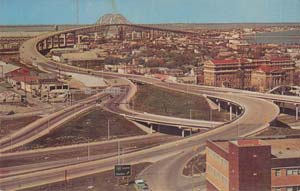 A 1960s Corpus Christi postcard features the courthouse and the new Bay Bridge.