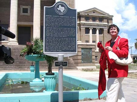 Friends of the Courthouse founder Margaret Ramage unveils new historic marker in front of the 1914 Nueces County Courthouse.