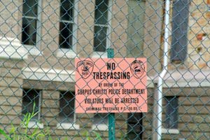 The 1914 courthouse is fenced and has NO TRESPASSING signs.