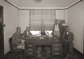 Five members gather for one of the building's earliest Commissioners' Court meetings.