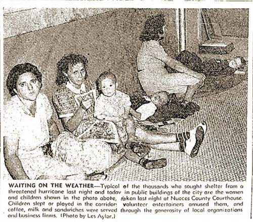 Waiting on the Weather: Women and children huddle for safety in the courthouse hallways during a hurricane in September of 1941.