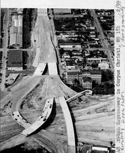 Construction of intersection of I-35 & US-181 in Corpus Christi, circa 1959. The pedestrian ramp that leads to the courthouse had just been finished.
