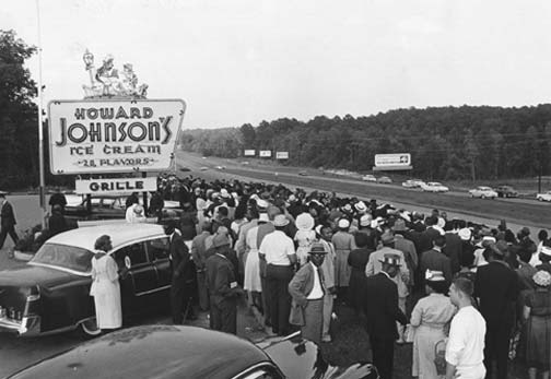 A crowd of 500 demonstrate at a segregation rally in front of a Howard Johnson's restaurant